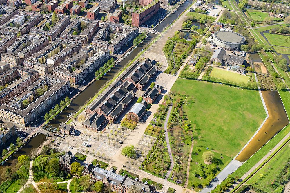Nederland, Noord-Holland, Amsterdam, 09-04-2014;<br /> Cultuurpark Westergasfabriek en Westerpark op het voormalige  Westergasterrein, langs de Haarlemmertrekvaart en de Haarlemmerweg. Links van het kanaal woonwijk de multiculturele Staatsliedenbuurt en bij oude watertoren de nieuwbouw Waterwijk.  <br /> <br /> Culture park Westergasfabriek and the Westerpark on the former Westergasterrein (gasworks), and residential district on the other side of the channel.<br /> luchtfoto (toeslag op standard tarieven);<br /> aerial photo (additional fee required);<br /> copyright foto/photo Siebe Swart