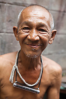 Thai Senior at Ban Bat Village or Monk Bowl Village where you will find Thai artisans making traditional alms bowls for monks who use traditional alms bowls to receive donations of food in the early morning.