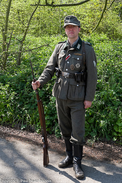 Reenactor portraying a member of 1 Kompanie Großdeutschland on gate duty at Fort Paull<br /> <br />   04May 2015<br />   Image © Paul David Drabble <br />   www.pauldaviddrabble.co.uk