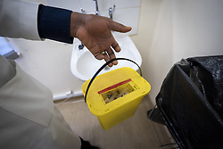 2 March 2017, Ma Mafefooane Valley, Lesotho: Dr N. G. Suaka at work at Saint Joseph's Hospital. Sharp objects are disposed in a solid container, so as to avoid contamination. Saint Joseph's Hospital is a district hospital in the Ma Mafefooane Valley in Lesotho. The hospital was established in 1937 and is run as a Roman Catholic non-profit institution by the Christian Health Association of Lesotho. As a district hospital, it offers comprehensive healthcare including male, female, paediatric, Tuberculosis and maternity care. It is closely linked with the neighbouring Roma College of Nursing, which runs on similar premises as part of the same institution. Drug supplies are secured to the hospital by means of a Memorandum of Understanding with the government.