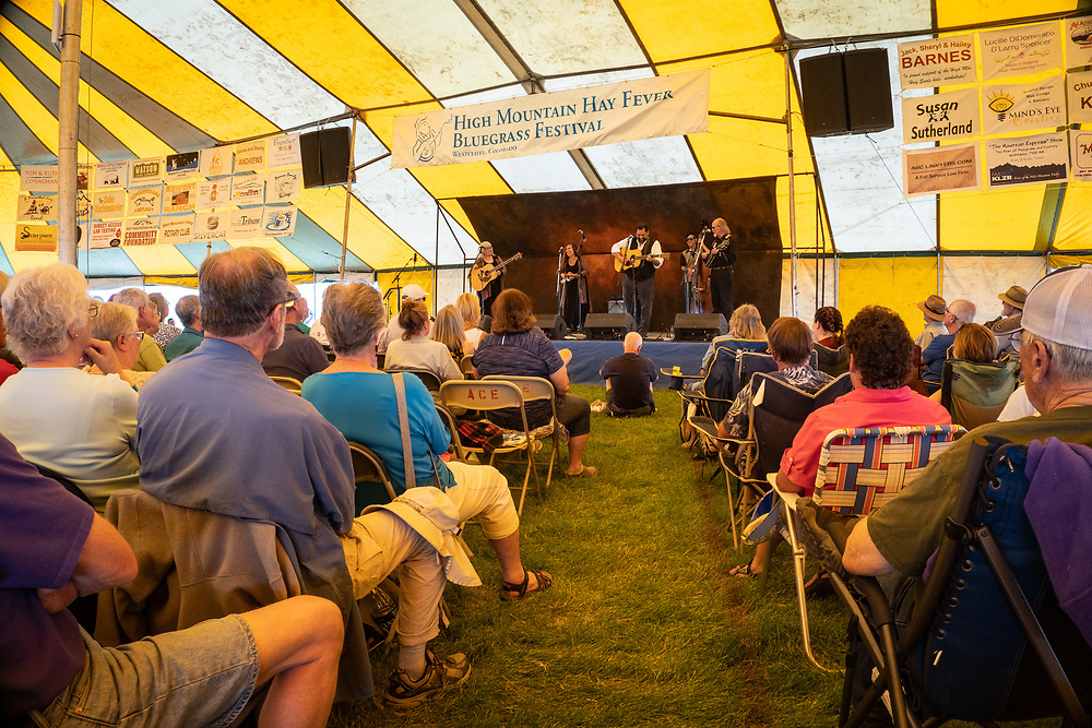 Attendees to 2019 High Mountain Hay Fever Bluegrass Festival enjoy July weather and amazing scenery from the circus tent in Westcliffe's Bluff Park.