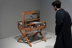 """© Licensed to London News Pictures. 09/10/2018. LONDON, UK. A visitor views Anni Albers's """"eight harness Structo-Artcraft 750 loom"""".  Preview of the UK's first exhibition of works by German artist Anni Albers at Tate Modern who used the ancient art of hand-weaving to produce works of modern art.  Over 350 of her artworks from major collections from Europe and the US are on show 11 October to 27 January 2019.  Photo credit: Stephen Chung/LNP"""