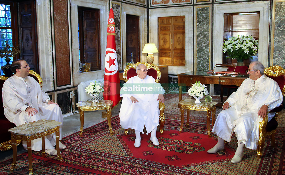 July 25, 2018 - Bardo, Tunisia - On 25 July 2018, the President of the Republic, Béji Caid Sibsi, presided over the parade marking the 61st anniversary of the Republic's declaration..The convoy was attended by the President of the Chamber of Deputies Mohamed Naceur(R), the Prime Minister Youssef Chahid(L), its members, deputies, national figures, representatives of national bodies, organizations, parties and members of the diplomatic corps accredited in Tunisia. (Credit Image: © Chokri Mahjoub via ZUMA Wire)