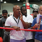 LAS VEGAS, NV - SEPTEMBER 13: Former champion Mike Tyson screams at some boxers in the mini ring during the Box Fan Expo at the Las Vegas Convention Center on September 13, 2014 in Las Vegas, Nevada.   (Photo by Alex Menendez/Getty Images) *** Local Caption ***Mike Tyson