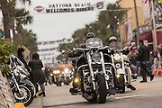 Bikers ride down Main Street during the 74th Annual Daytona Bike Week March 7, 2015 in Daytona Beach, Florida.
