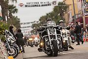 Bikers ride down Main Street during the 74th Annual Daytona Bike Week March 7, 2015 in Daytona Beach, Florida.