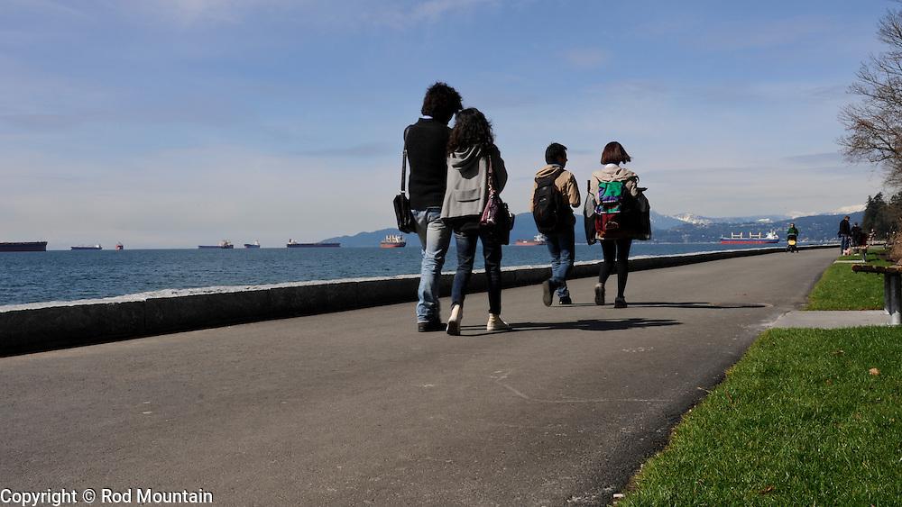 People walking along the path at English Bay, Vancouver, B.C