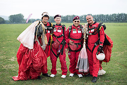 © Licensed to London News Pictures. 25/08/2016. <br /> <br /> Pictured: Fred Glover and Ted Pieri, two D-Day veterans who are both 90 years old pose for a group photograph with members of the Red Devils Parachute display team after they parachuted into Sarum Airfield, Wiltshire on Thursday 25th August 2016, 72 years after D-Day having earlier in the month jumped into Merville Battery in France.<br /> <br /> Photo credit should read Max Bryan/LNP
