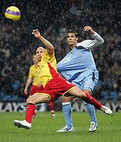 Photo: Paul Thomas.<br /> Manchester City v Watford. The Barclays Premiership. 04/12/2006.<br /> <br /> Bernardo Corradi (R) of Man City has the ball cleared it front of him by Gavin Mahon of Watford.