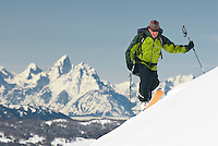A young man climbs a hillside while backcountry skiing on Togwotee Pass in Jackson Hole, Wyoming.