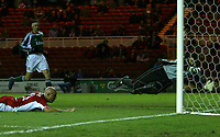 Photo: Andrew Unwin.<br /> Middlesbrough v Liteks Lovech. UEFA Cup. 15/12/2005.<br /> Middlesbrough's Massimo Maccarone (L) heads home his team's first goal past Liteks Lovech's Vitomir Hristov Vutov (R).