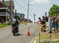 The crowd cheers on riders as they race up Tower Hill on Tuesday during the Tower Hill Climb at Weirs Beach.  (Karen Bobotas/for the Laconia Daily Sun)