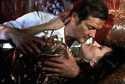 May 24, 2002; Hollywood, CA, USA; Actor ROGER MOORE as James Bond 007 and Actress MAUD as Octopussy star in 'Octopussy' directed by JOHN GLEN II..  (Credit Image: ZUMA Press/ZUMAPRESS.com) (Credit Image: © ZUMA Press/Entertainment Pictures/ZUMAPRESS.com)