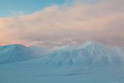 Sunset light on Helvetiafjellet (right) and Bassen, Svalbard.
