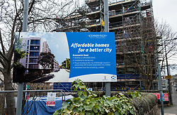 Sign outside new-build apartment building by Cala indicating that homes are affordable homes partly funded by the Scottish Government in Brunswick Road Edinburgh, Scotland, United Kingdom