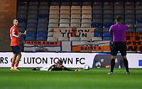 Football - 2020 / 2021 EFL Carabao Cup - Round Three - Luton Town vs Manchester United<br /> <br /> Referee Tim Robinson awards a penalty as Luton Town's George Moncur fowls Manchester United's Brandon Williams, at Kenilworth Road.<br /> <br /> COLORSPORT/ASHLEY WESTERN