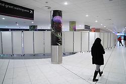 Edinburgh, Scotland, UK. 15 Feb 2021. From today Scottish Government requires all passengers from overseas arriving at Scottish airports to go into a mandatory quarantine in a hotel. Pic; Arrivals area has been screened off to comply with Government regulations. Iain Masterton/Alamy Live news