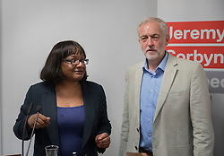 © Licensed to London News Pictures. 24/08/2016. London, UK. Labour party leader Jeremy Corbyn answers journalists questions after speaking on NHS issues with Diane Abbott. Mr Corbyn faces increasing criticism after appearingng in a video sitting on the floor of a crowded train.  Virgin trains owner Sir Richard Branson released cctv footage appearing to show that seats were available. Photo credit: Peter Macdiarmid/LNP