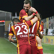 Galatasaray's Burak Yilmaz celebrate his goal with team mate during their Turkish Super League soccer match Akhisar Belediye Genclik Spor between Galatasaray at the 19 Mayis Stadium in Manisa Turkey on Monday, 04 May 2015. Photo by Kurtulus YILMAZ/TURKPIX