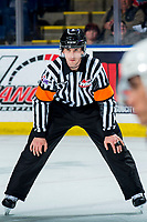 KELOWNA, BC - MARCH 6: Referee Bryan Bourdon stands on the ice for the face-off between Kelowna Rockets and Seattle Thunderbirds at Prospera Place on March 6, 2020 in Kelowna, Canada. (Photo by Marissa Baecker/Shoot the Breeze)