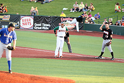11 July 2012:  Pitcher Gary Lee (Washington Wild Things) peers over at runner Abel Nieves (Joliet Slammers) who is taking a lead off the base protected by Joash Brodin (London Rippers) during the Frontier League All Star Baseball game at Corn Crib Stadium on the campus of Heartland Community College in Normal Illinois