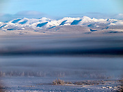 The Pole of Cold - mountains surrounding Tomtor village seen from a nearby mountain. The area is extremely cold during the winter. Two towns by the highway, Tomtor and Oymyakon, both claim the coldest inhabited place on earth (often referred to as -71.2°C, but might be -67.7°C) outside of Antarctica. The average temperature in Oymyakon in January is -42°C (daily maximum) and -50°C (daily minimum). The images had been made during an outside temperature in between -50°C up to -55°C. Tomtor, Jakutien, Yakutia, Russian Federation, Russia, RUS, 19.01.2010