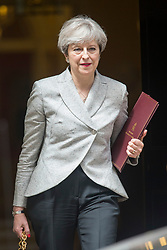 © Licensed to London News Pictures. 13/06/2017. London UK. Theresa May leaves Downing street this afternoon after meeting with DUP leader Arlene Foster for talks on a deal to prop up a Tory minority administration. Photo credit: Andrew McCaren/LNP