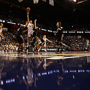 Gabby Williams, UConn, shoots past Shelbi Chandler, (left) and Chelsea Jamison, Cincinnati, during the UConn Vs Cincinnati Quarterfinal Basketball game at the American Women's College Basketball Championships 2015 at Mohegan Sun Arena, Uncasville, Connecticut, USA. 7th March 2015. Photo Tim Clayton