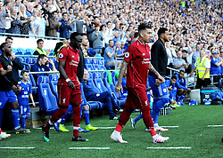 Naby Keita  and Roberto Firmino of Liverpool walk out on to the pitch prior to kick-off - Mandatory by-line: Nizaam Jones/JMP - 21/04/2019 -  FOOTBALL - Cardiff City Stadium - Cardiff, Wales -  Cardiff City v Liverpool - Premier League