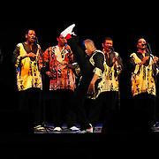 Ladysmith Black Mambazo member Msizi Shabalala high kicking at The Music Hall, Portsmouth, NH