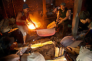 I visited a workshop where they were making gongs in the traditional way.  This hot, sweaty work is said to produce gongs of a much higher quality than newer, faster methods.