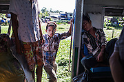 A teenage boy hops on board the train as it speeds off to the next station near Danyingon, a suburb of Yangon. The Yangon Circular Railway is a large means of transport in Yangon and is frequented by more than 100,000 people each day