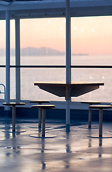 Boat ferry cruise ship deck sunrise table chairs