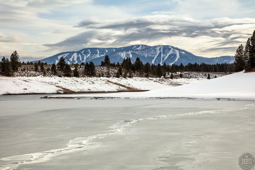 """""""Frozen Prosser Reservoir 6"""" - Photograph of a big crack in the ice on a frozen over Prosser Reservoir in Truckee, California. Northstar Ski Resort can be seen in the distance."""