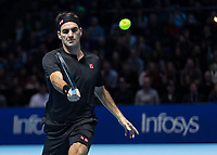 Tennis - 2019 Nitto ATP Finals at The O2 - Day One<br /> <br /> Singles Group Bjorn Borg: Roger Federer (Switzerland) vs. Dominic Thiem (Austria)<br /> <br /> Roger Federer (Switzerland) with a return of serve <br /> <br /> COLORSPORT/DANIEL BEARHAM