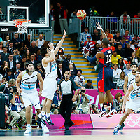 06 August 2012: USA Chris Paul goes for the floater over Argentina Facumdo Campazzo during 126-97 Team USA victory over Team Argentina, during the men's basketball preliminary, at the Basketball Arena, in London, Great Britain.