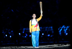 A baton torchbearer during the Opening Ceremony for the 2018 Commonwealth Games at the Carrara Stadium in the Gold Coast, Australia.