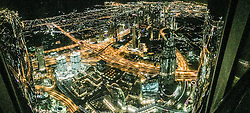 An iPhone6 panoramic image, Night pic form the observation deck on the 124th floor of the Burj Al Khalifa building, currently credited as being the world's tallest building. Images from the MSC Musica cruise to the Persian Gulf, visiting Abu Dhabi, Khor al Fakkan, Khasab, Muscat, and Dubai, traveling from 13/12/2015 to 20/12/2015.