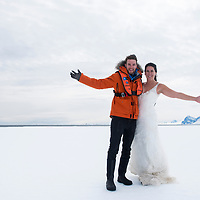 A newlywed couple on their Honeymoon pose on the fast ice while in Crystal Sound, Antarctica.