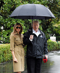 September 2, 2017 - Washington, District of Columbia, U.S. - United States President Donald J. Trump and first lady Melania Trump look towards the press pool prior to their Marine One departure from the White House. The President and first lady are traveling to Texas to visit individuals impacted by Hurricane Harvey. (Credit Image: © Olivier Douliery/CNP via ZUMA Wire)