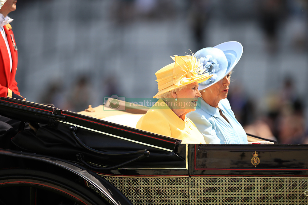 Queen Elizabeth II and the Duchess of Cornwall ride a carriage to the parade ring during day two of Royal Ascot at Ascot Racecourse.