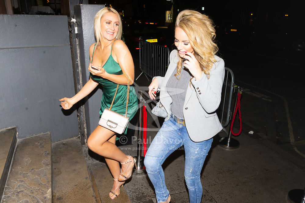Former Playboy model Hayley Bray, left, is photographed as she arrives with glamour model XXX at Studio 61 Cocktail Bar at Sway in Holborn. LONDON, December 28 2018.
