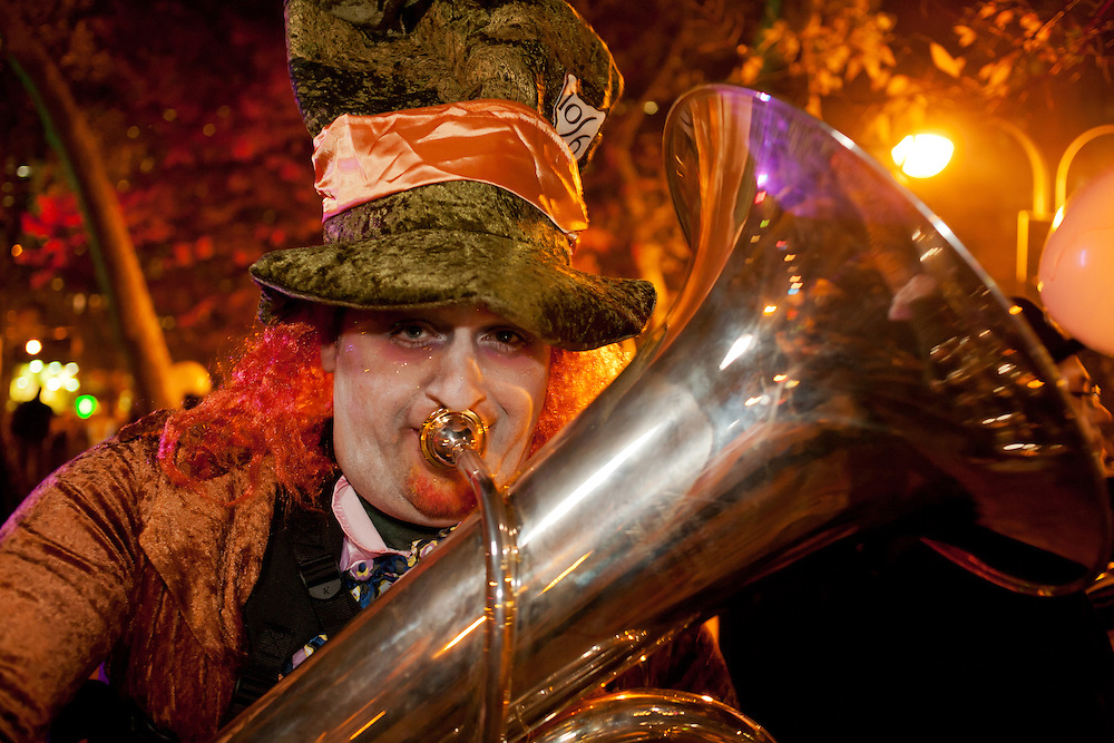 The Mad Hatter plays a tuba.
