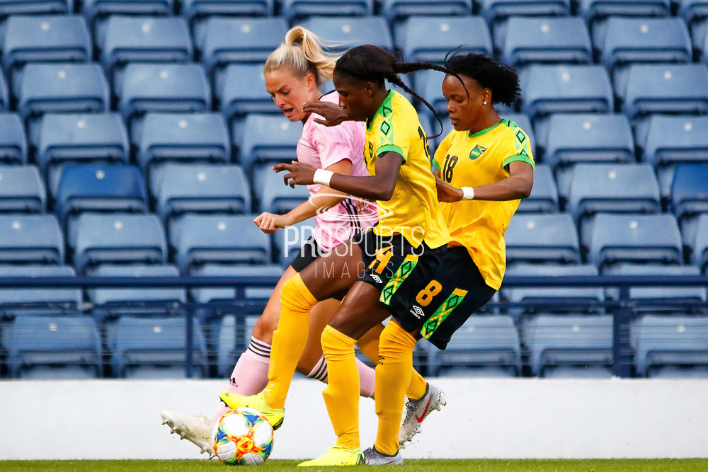 The Jamaican pair of Deniesha BLACKWOOD (Univ. West Florida (USA)) & Trudi CARTER (AS Roma (ITA)) hustle for possession during the International Friendly match between Scotland Women and Jamaica Women at Hampden Park, Glasgow, United Kingdom on 28 May 2019.