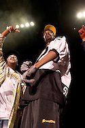 """Snoop Dogg performing wearing face paint..Battlezone 2005 held at the Great Western Forum in Inglewood, CA. Krumpers and Clown dancers from South Central LA showcase their dancing skills in a yearly competition. Tommy Johnson, aka """"Tommy the Clown"""" started the Clown dance and Krumping movement in South Central LA as a real alternative to gangs and crime. The high energy Krumping and Clown dancing are hip hop based with African tribal dancing tributes. Face paint is often worn to distinguish the dancers unique dance styles, most are clown like with graffiti accents. The dance movement was made popular by the recent documentary """"Rize"""" by photographer David LaChappelle which featured """"Tommy The Clown"""".."""