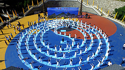 July 7, 2017 - Luoyan, China - More than 200 women practice Tai Chi and yoga at Luojun Mountains in Luoyang, central China's Henan Province. (Credit Image: © SIPA Asia via ZUMA Wire)