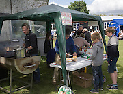 Hot dog and burger stall at village summer fete, Bawdsey, Suffolk, England