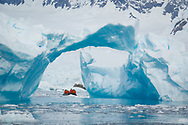 Zodiac cruising among the icebergs in Lindblad Cove, Antarctica