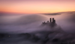 © Licensed to London News Pictures. 21/01/2020. Corfe Castle, UK. Corfe Castle in Dorset shrouded in mist as large parts of the UK are hit by freezing temperatures. Photo credit: Peter Scott/LNP