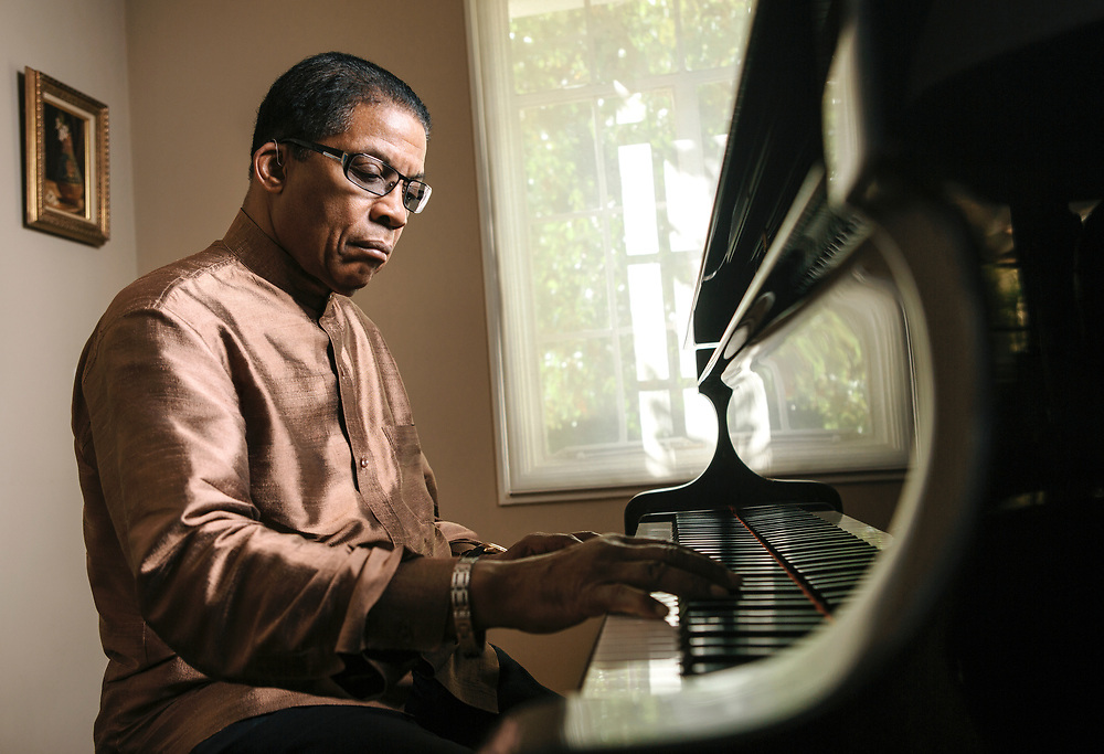LOS ANGELES, CA - OCTOBER 18, 2013 - Jazz musician Herbie Hancock poses next to his piano at his home on October 18, 2013, in Los Angeles, California. Hancock is one of the five recipients of the 2013 Kennedy Center Honors. (Photo by Bret Hartman/For The Washington Post)